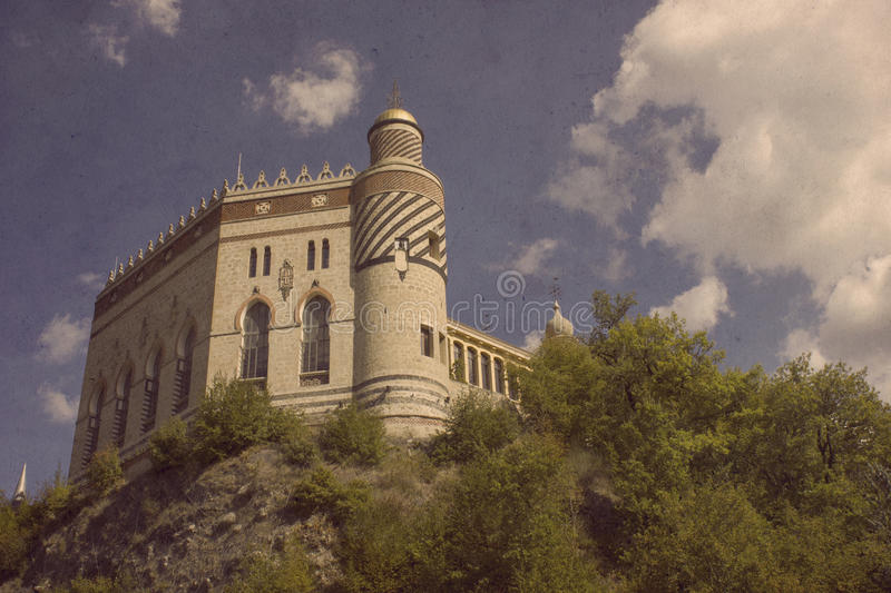 Ancient castle in to the forest stock image