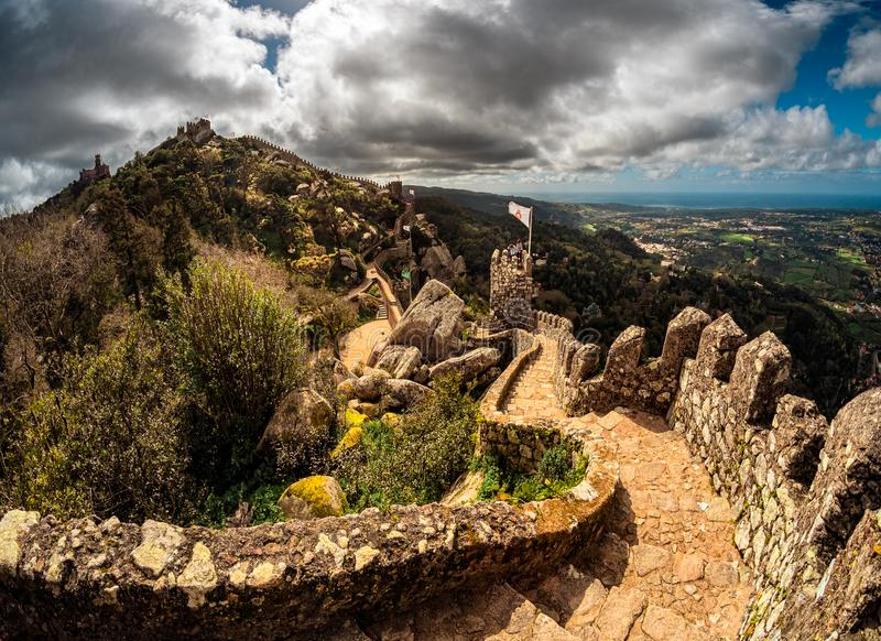 Ancient castle walls. Old stones on the top of the hill of the Moors castle in the city of Sintra. Lisbon. View of the Portuguese plains from a bird`s eye view stock images