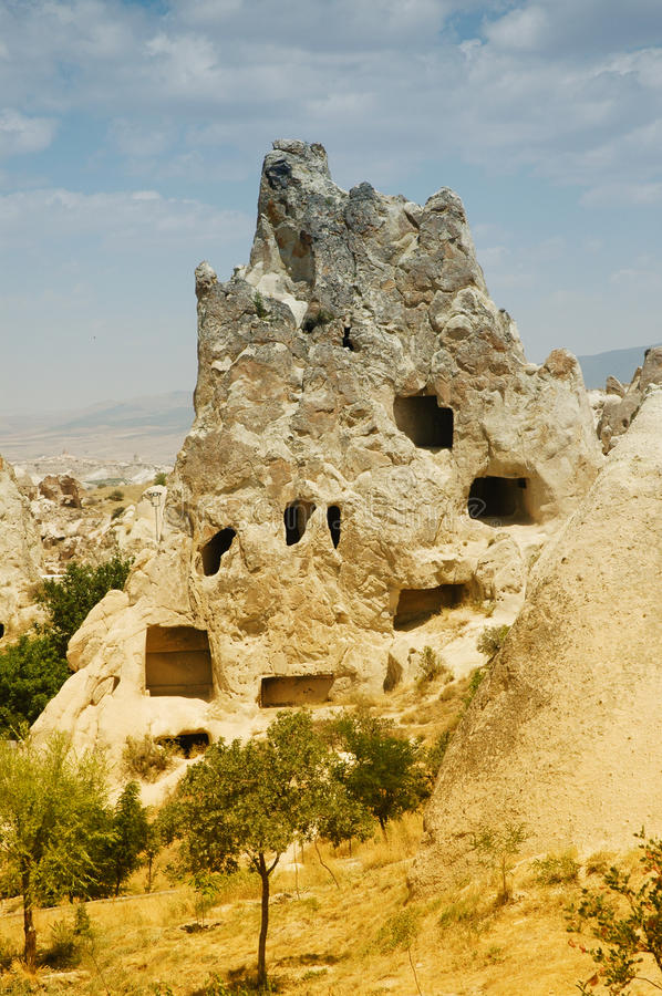 Ancient cave-town near Goreme, Cappadocia, Turkey royalty free stock photo