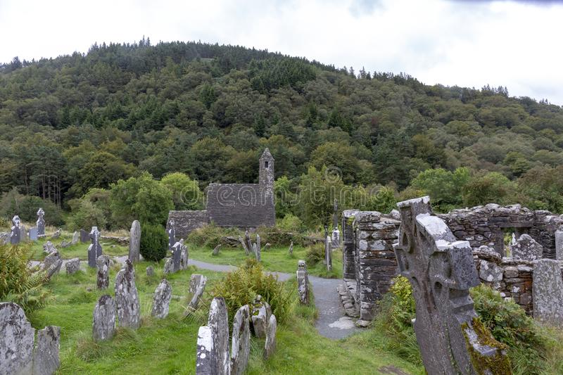 Ancient Celtic gravesite with unmarked gravestones and old rundown church royalty free stock photography