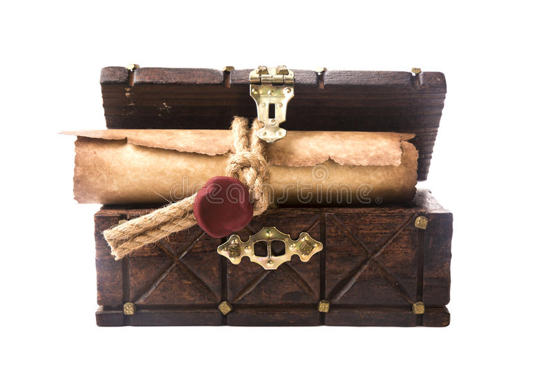 The ancient chest and a scroll with a seal isolated on white royalty free stock image