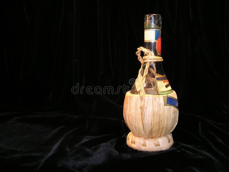 Ancient Chianti bottle stock image