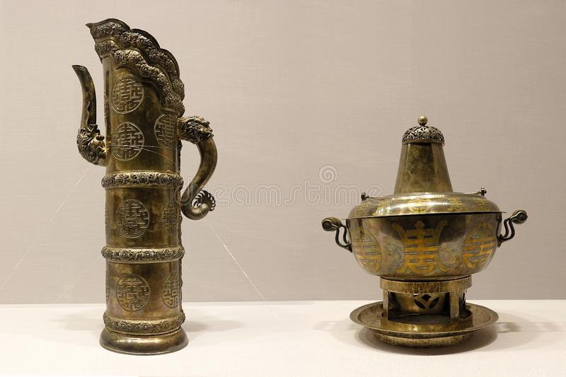 Ancient Chinese chafing dish and kettle. The close-up of ancient Chinese chafing dish collected by Imperial Palace Museum royalty free stock photography