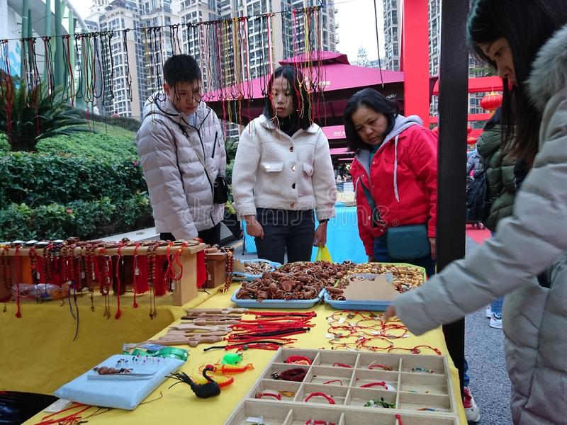 Ancient Chinese COINS, and ancient COINS woven into handicrafts. In shenzhen baoan New Year goods market to sell stock image