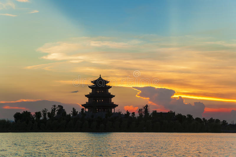 Ancient chinese pavilion under sunset royalty free stock photos