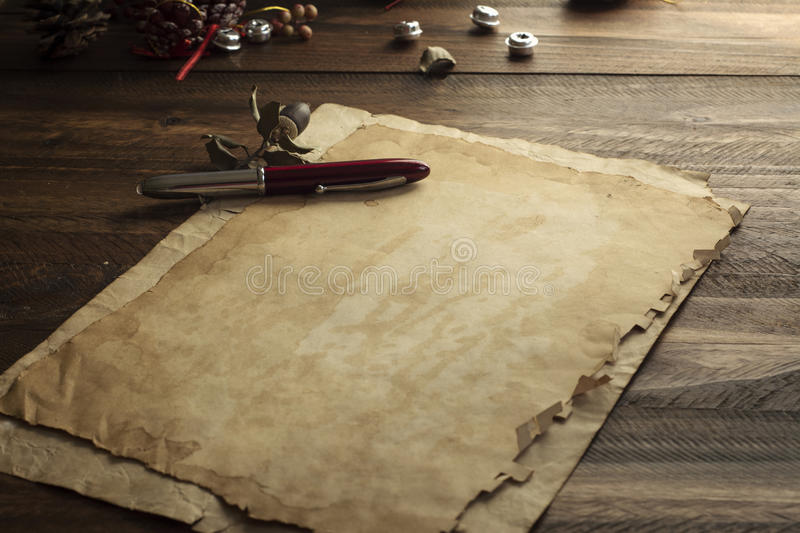 Ancient Christmas card, paper on rustic wood stock images