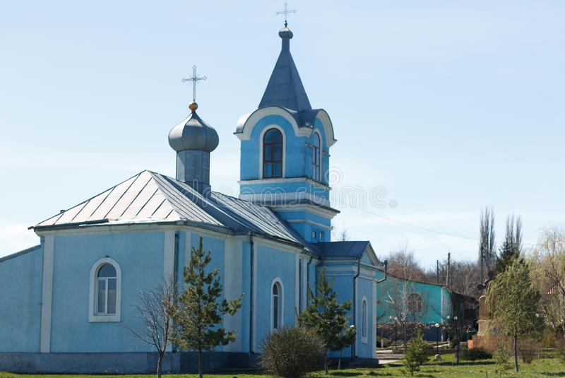 Ancient church of blue color close up in village. On sky background royalty free stock photo