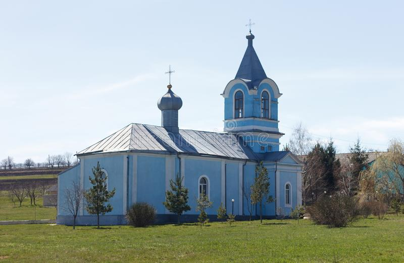 Ancient church of blue color in village. On sky background royalty free stock images