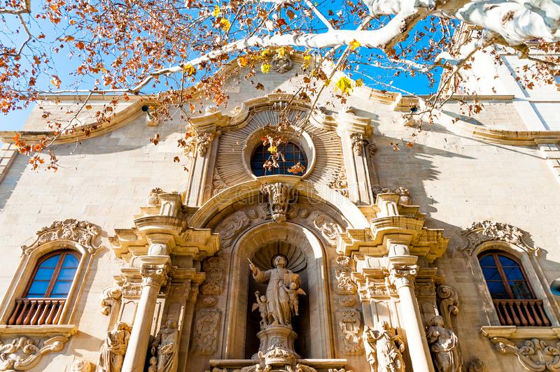 Close up view of front facade of Collegiate Basilica of Santa Maria Seu in Manresa city in catalunya region in Spain, with trees. Ancient church at sunset in stock photo