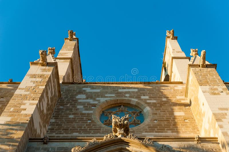 Detail of gargoyles in modernist style of Basilic of Santa Maria Seu in Manresa city in catalunya region in Spain with clear blu. Ancient church at sunset in stock photo