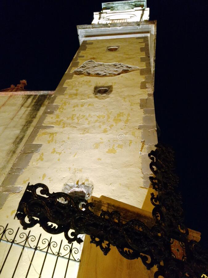 An ancient church tower and cross, Queretaro, Mexico. An ancient church tower and cross at night, Queretaro, Mexico, from colonial times stock photos