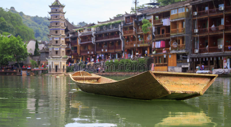 Ancient City Fenix in China. Historic Asian Scenery with Water Canals, Wooden Houses, Gondola Boats. Photo of Ancient City Fenix in China. Historic Asian Scenery stock photography