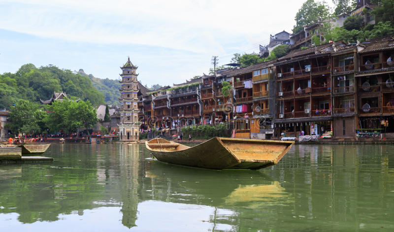 Ancient City Fenix in China. Historic Asian Scenery with Water Canals, Wooden Houses, Gondola Boats. Photo of Ancient City Fenix in China. Historic Asian Scenery stock image