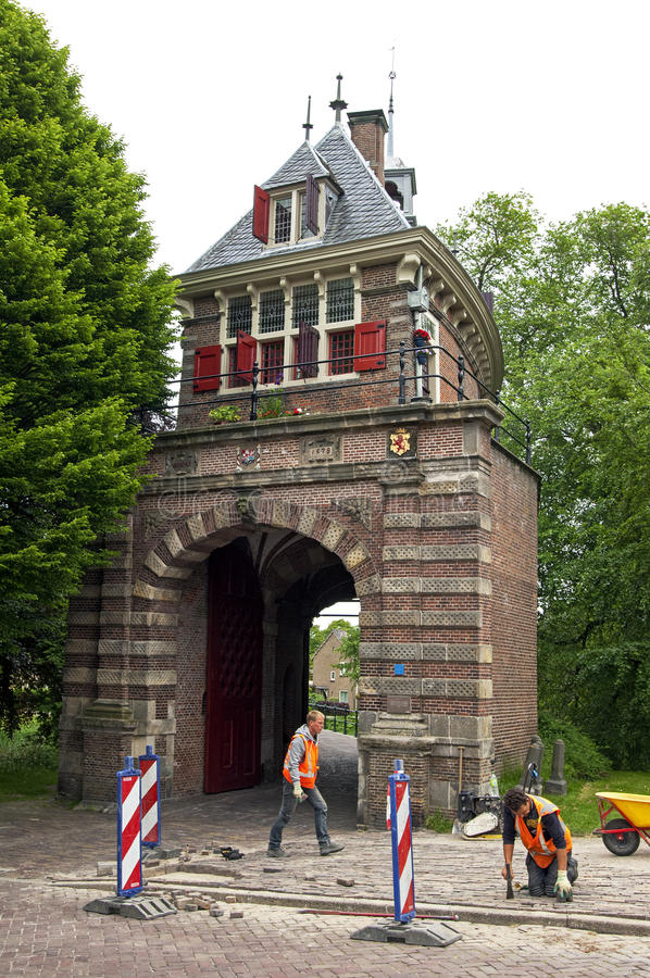 Ancient city gate and paviours in Hoorn. Netherlands, province North-Holland small city Horn, municipality Drechterland: on the street the Draafsingel [former stock image
