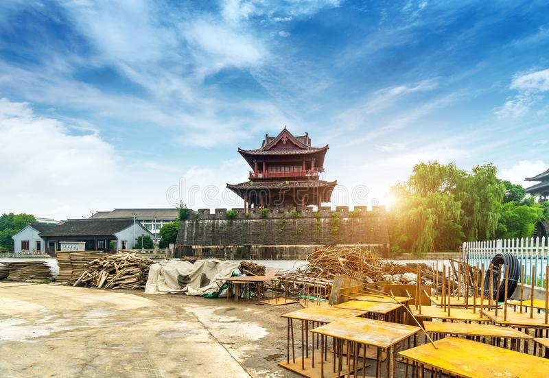 Ancient City Wall. Construction site, the ancient city wall is being repaired, Shaoxing, Zhejiang, China.Translation:`Concentric, accumulate strength stock image