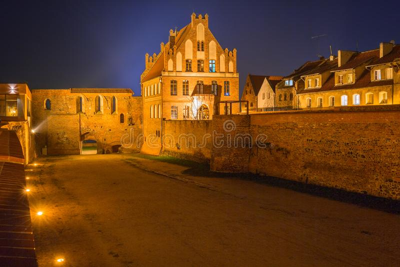 Ancient city walls of Torun at night, Poland stock image