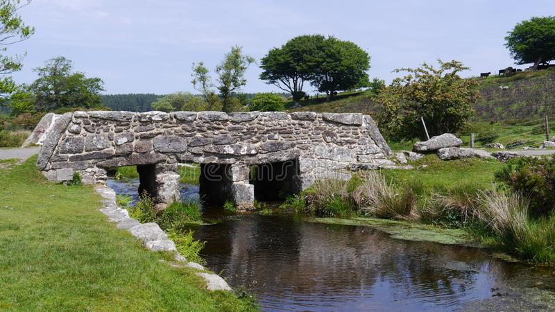 Ancient Clapper Bridge in Dartmoor National Park South West England. An ancient clapper bridge - or pack horse bridge as they`re sometimes known in Dartmoor royalty free stock photos