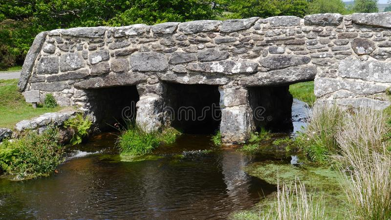 Ancient Clapper Bridge in Dartmoor National Park South West England. An ancient clapper bridge - or pack horse bridge as they`re sometimes known in Dartmoor royalty free stock images