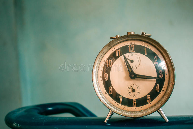 Ancient clock. On a blue background royalty free stock photos