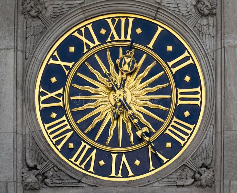 Ancient clock. Gold and blue ancient clock stock photos