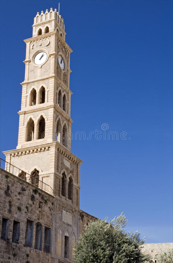 Ancient clock tower in acre stock photography