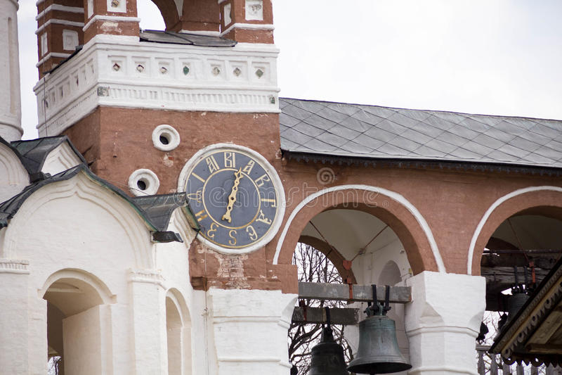 The ancient clock on the wall of the Church, city Suzdal, Golden ring of Russia stock images