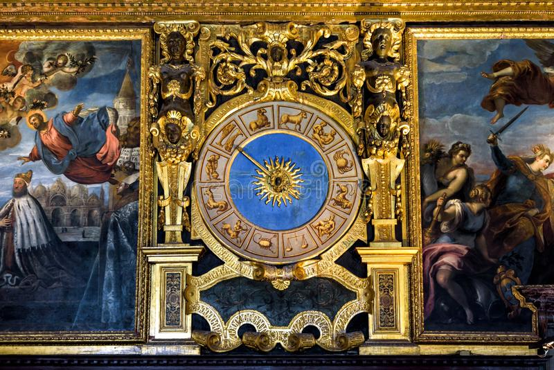 Ancient clock with Zodiac signs in Doge`s Palace, Venice royalty free stock photo