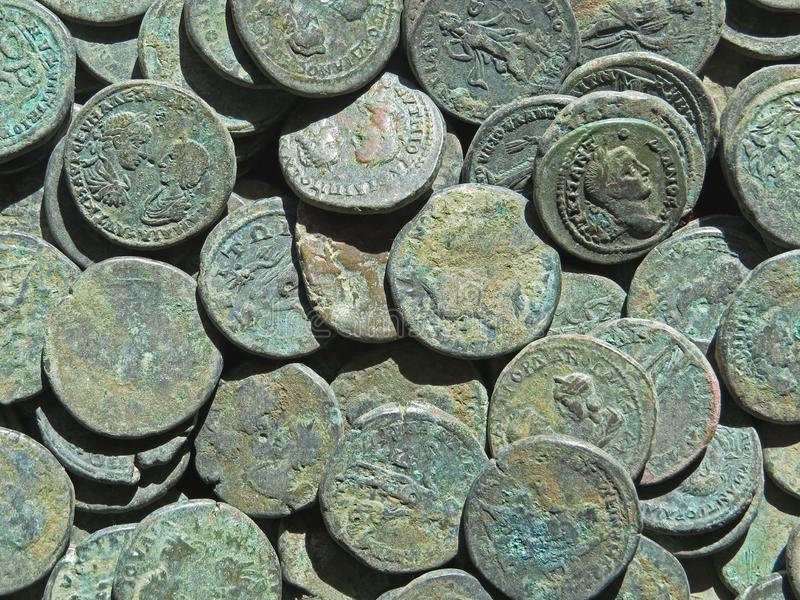 Ancient coin treasure. Stamped copper round money. Bunch of ancient coin treasure. Stamped copper round money royalty free stock photos