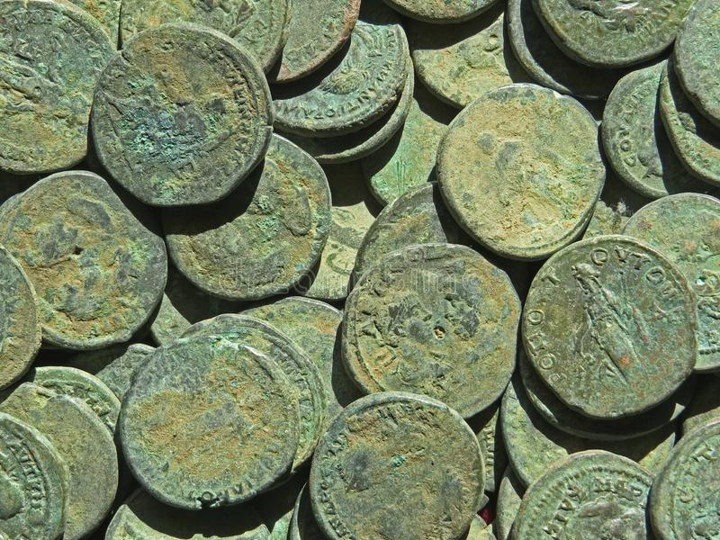 Ancient coin treasure. Stamped copper round money. Bunch of ancient coin treasure. Stamped copper round money royalty free stock photo