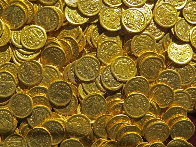 Ancient coin treasure. Stamped golden round money. Bunch of ancient coin treasure. Stamped golden round money royalty free stock photography