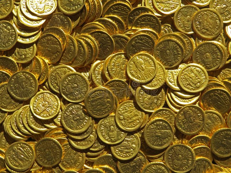 Ancient coin treasure. Stamped golden round money. Bunch of ancient coin treasure. Stamped golden round money royalty free stock images