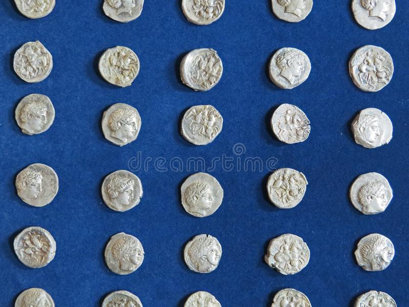 Ancient coin treasure. Stamped silver round money. Bunch of ancient coin treasure. Stamped silver round money stock photos