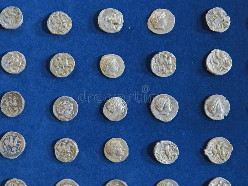 Ancient coin treasure. Stamped silver round money. Bunch of ancient coin treasure. Stamped silver round money royalty free stock photo