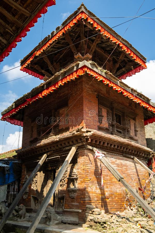 An ancient collapsing Hindu three-story temple on a stone pedestal with wooden pillars. Durbar Square in Kathmandu, Nepal.  stock images
