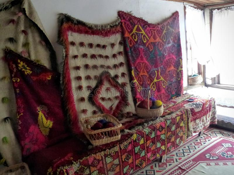 Ancient colored carpets in a house museum to Gjirokaster in Albania. stock photo