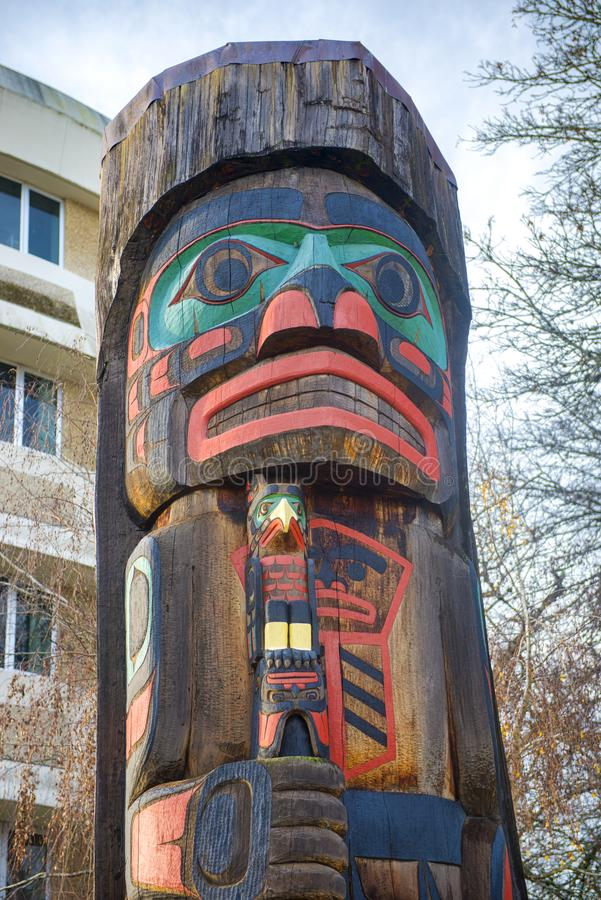 Ancient colorful Totem Pole in Duncan, British Columbia, Canada. View of ancient colorful Totem Pole with blue sky behind it in Duncan, British Columbia, Canada royalty free stock images