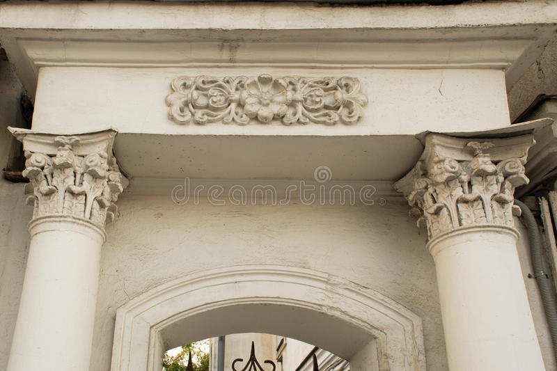 Ancient column with stucco and gate in Yaroslavl stock photos