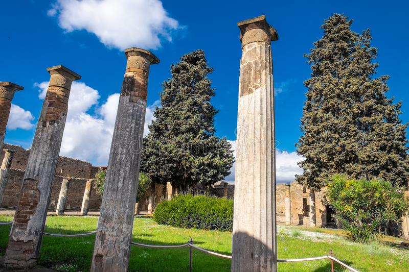 Ancient columns on the garden on Villa in Pompeii, destroyed city stock images