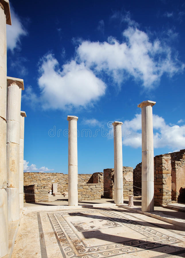 Ancient columns and mosaic in Delos, Greece. Ancient columns and floor mosaic in Delos, Greece royalty free stock photos
