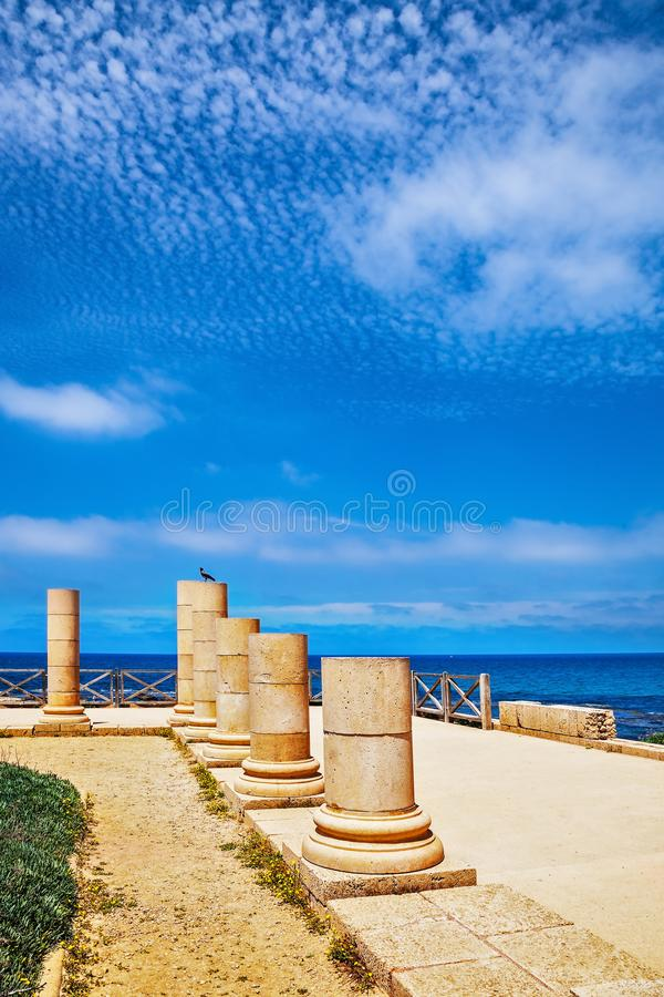 Ancient columns  in National Park Caesarea. Ancient columns from the Roman period on the coast. National Park Caesarea, Israel stock images