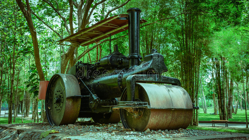 Ancient compactor is parked in the Park, to study closely, Yangon, Myanmar, April-2017 stock images