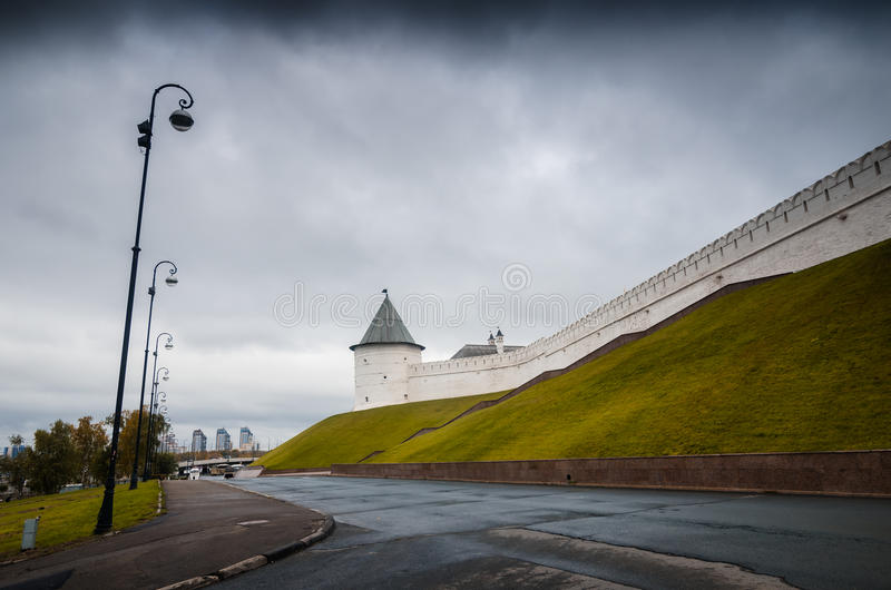 Ancient complex of monuments. Long white walls surrounding ancient complex of Kazan Kremlin in gloomy day stock photos