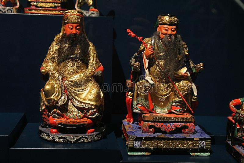 Confucian statues. Ancient confucian statues inside the confluence museum at lyon in france royalty free stock images