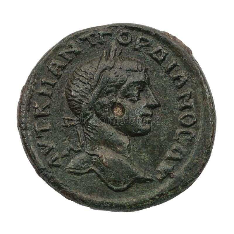 Ancient copper or bronze roman coin isolated on white royalty free stock image
