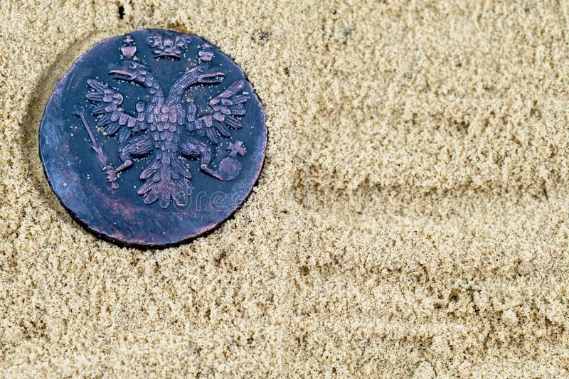 Ancient copper coin with the image of the double-headed eagle of 1715 Russian kopecks royalty free stock images