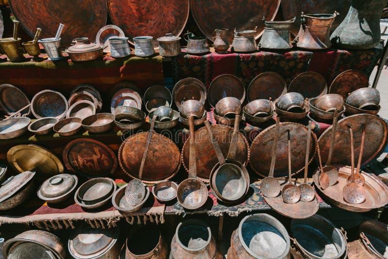 Ancient copper ware. Flea market Vernissage Yerevan, Armenia. stock photo
