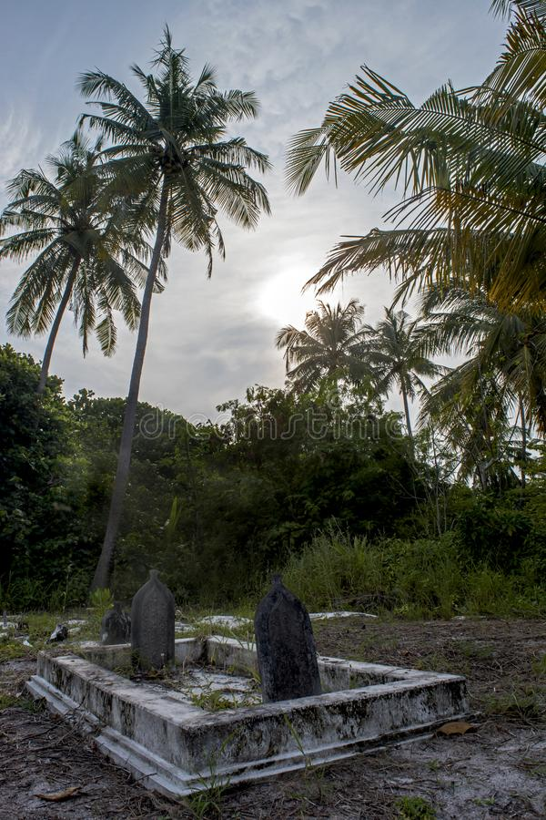 Ancient creepy graveyard with crypt and graves at the tropical local island Fenfushi royalty free stock photography