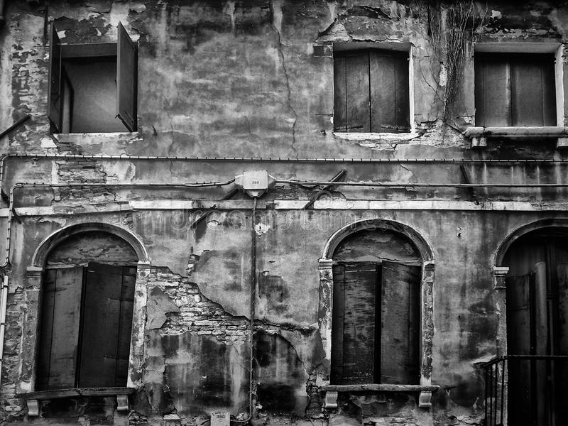 Ancient crumbling abandoned house with cracks stock image
