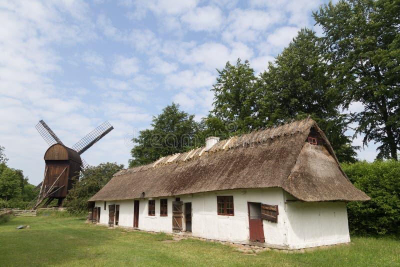 Ancient danish farmhouse and windmill stock photos