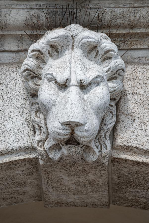 Ancient decoration element of scary lion head at roof of Basilica San Marco and Doge Palace  in Venice, Italy royalty free stock photography